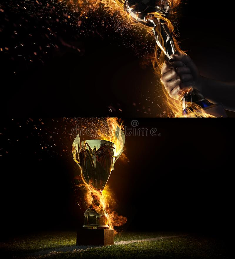 Sports background. Sport collage with fire and energy. Man`s hand holding up trophy goblet. Winner in a competition. stock photos