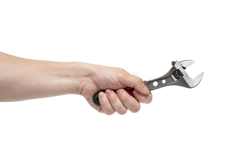 Man`s hand holding wrench isolated over white. The hand holds a wrench on white background stock photo