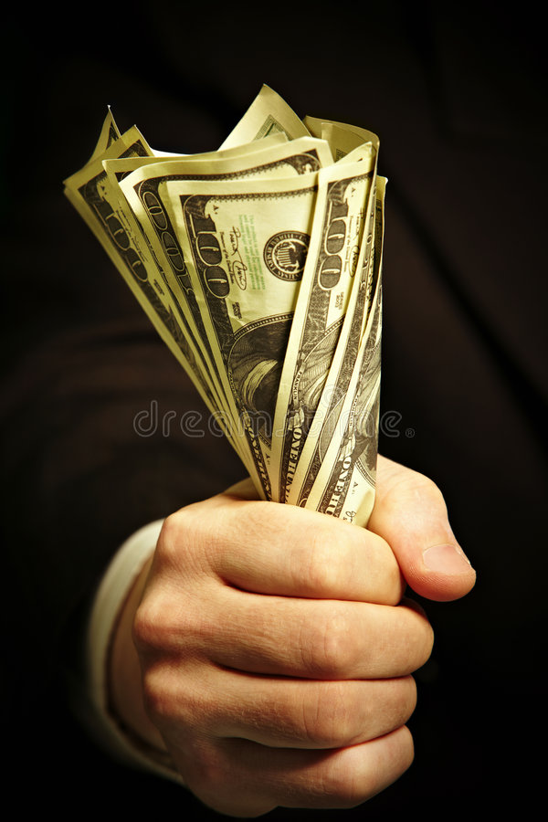 Man S Hand Holds Dollars Royalty Free Stock Images