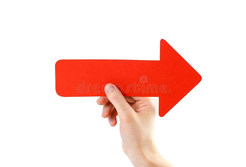 A man`s hand holds a large red arrow. Close up. Isolated on a wh royalty free stock photography