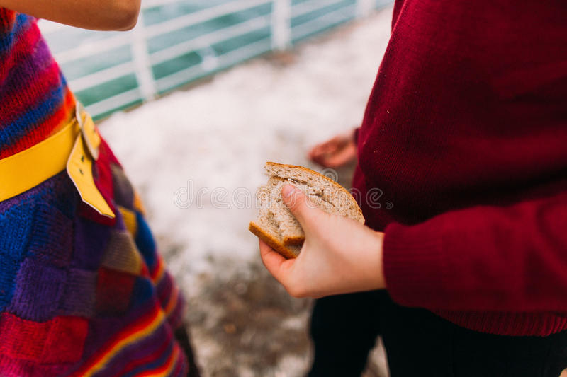 Man's hand holds a slice of whole weat bread. Sea background. Creative concept.  stock photos