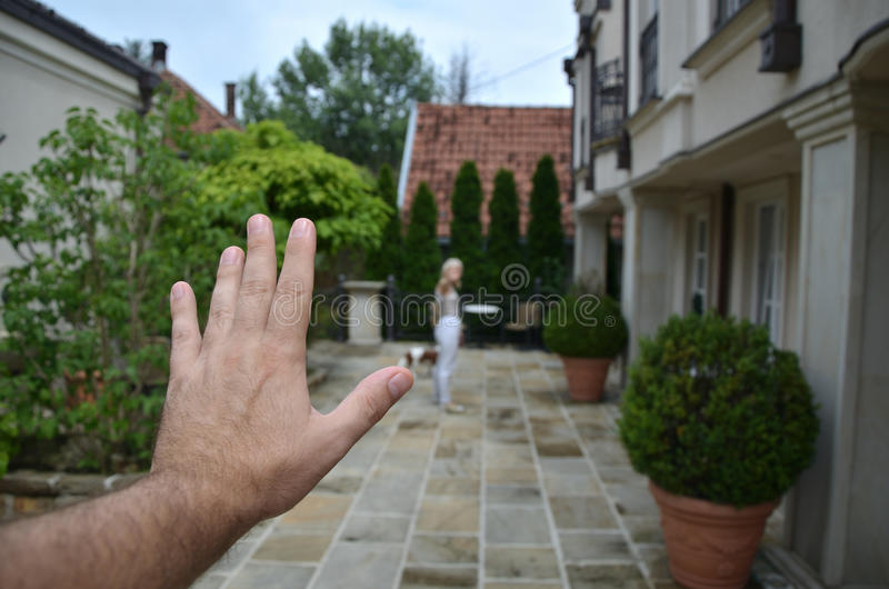 Man`s Hand and Leaving Woman stock images