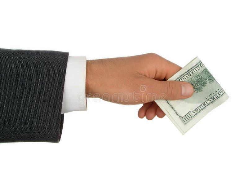 Man's hand offering money. stock image