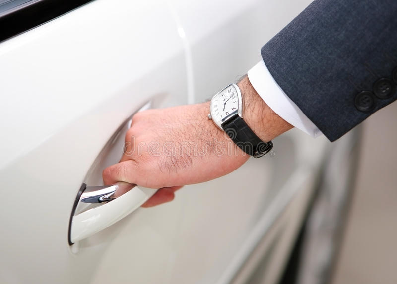 Mans hand opening luxury car door royalty free stock photos