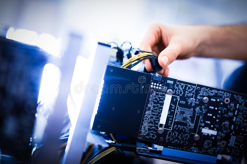 Download Man`s Hand Plugging A Wire In An Input. Stock Image - Image of assemble, cryptocurrency: 105707503