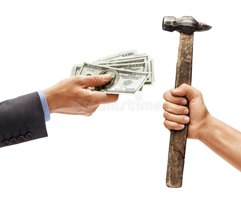Man`s hand in suit giving cash money and man`s hand holding a hammer royalty free stock photo