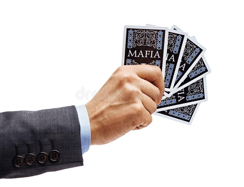 Man`s hand in suit holding playing cards isolated on white background. Close up. High resolution product stock image