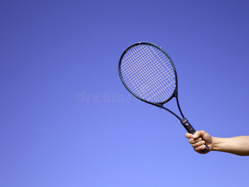 Man's hand with tennis racket royalty free stock photo