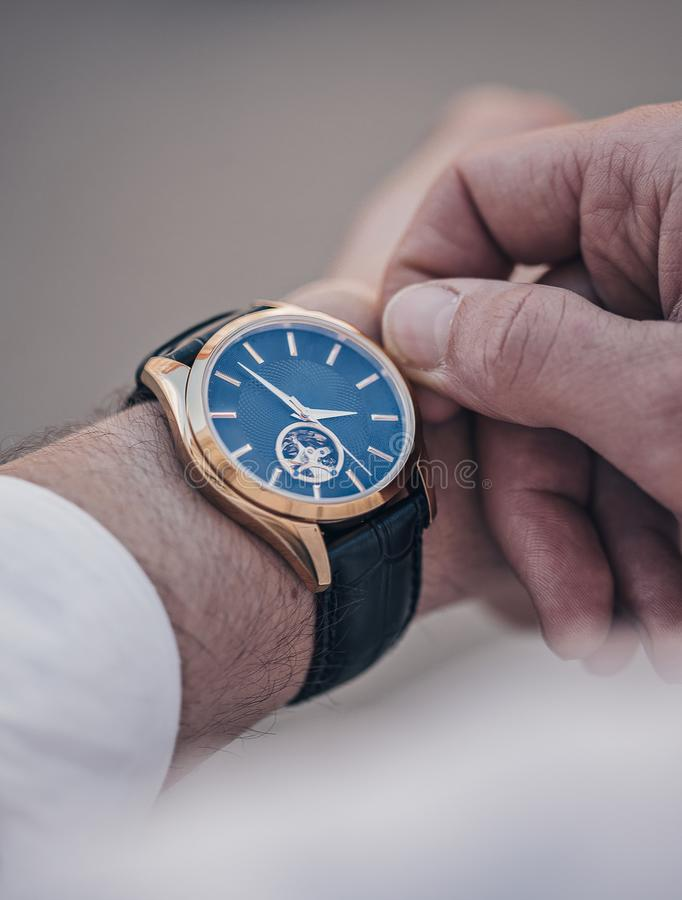 Man`s hand with a watch royalty free stock image