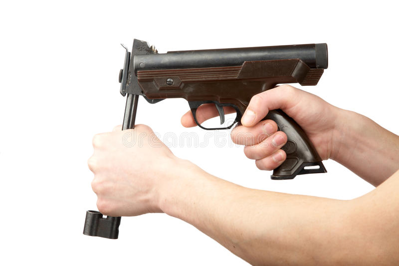 Download Man's Hands Charge A Pneumatic Pistol Stock Image - Image: 13164789