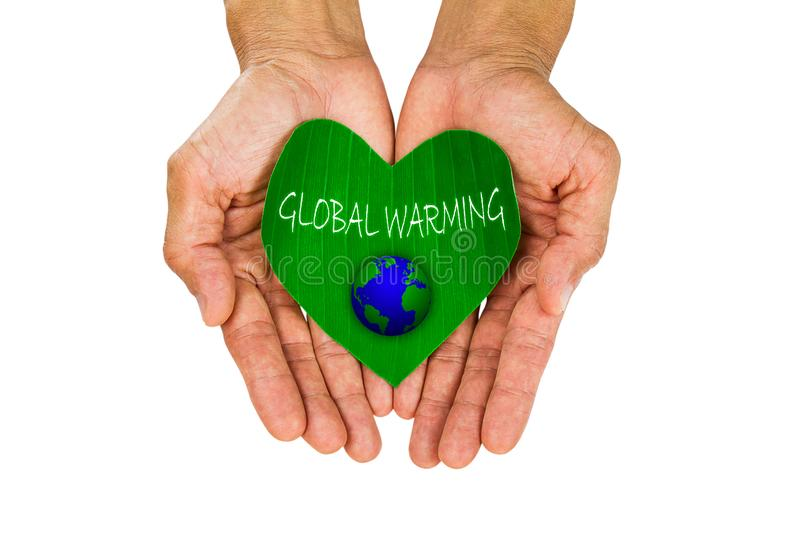 Man`s hands holding heart shaped green leaf with earth and letter global warming on white background stock photos