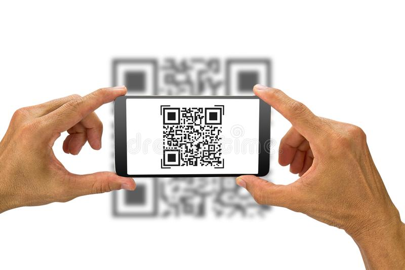 Man`s hands holding smartphone scanning QR code on white background. Technology concept stock photography