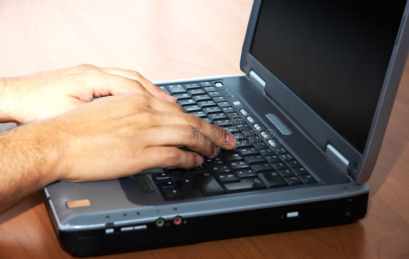 Man's hands on the laptop stock image