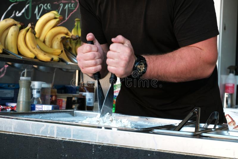 Man making thai rolled ice cream close-up stock photography