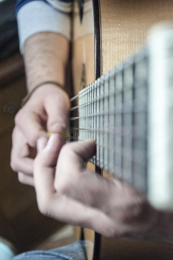 Free Man`s Hands Playing Guitar. Royalty Free Stock Photography - 133909757