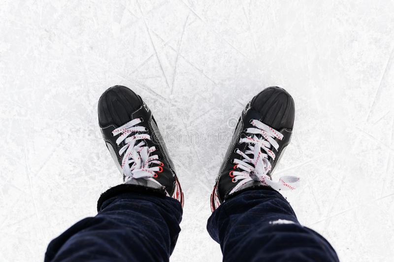 Man's hockey skates on ice background. People skate on the rink. Weekend entertainment in the winter outdoors royalty free stock image