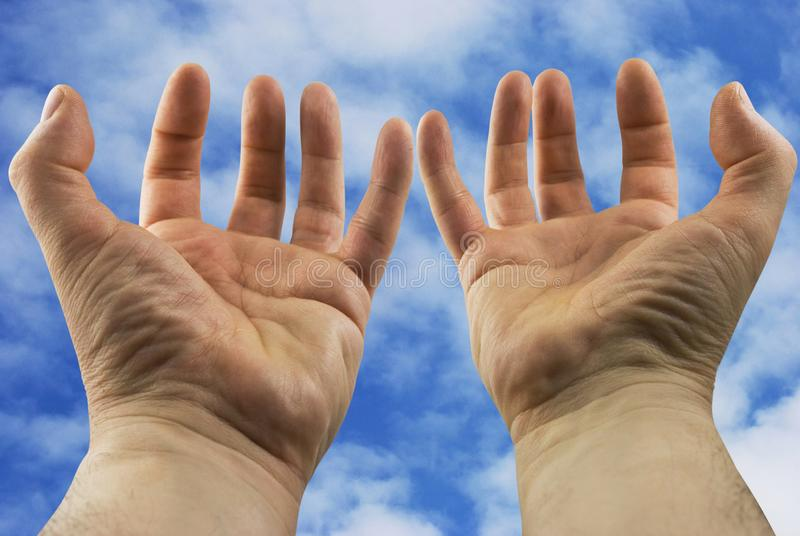 Hands stretched towards the sky stock photos