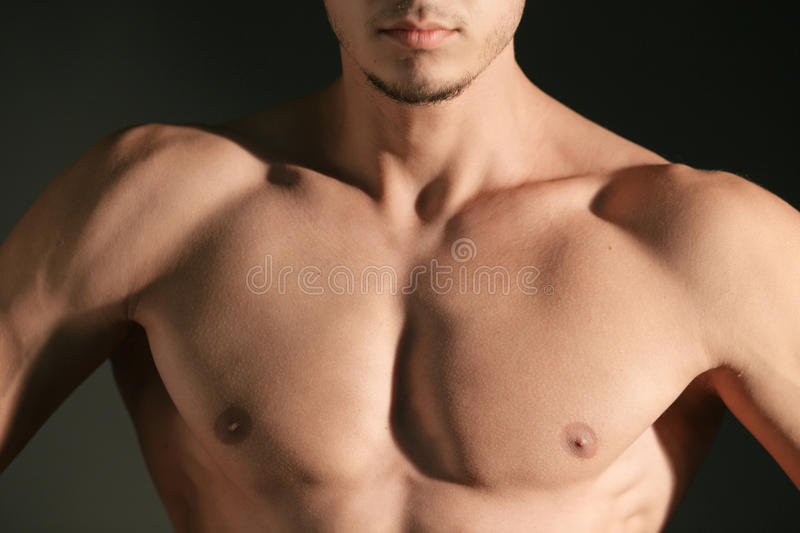Man's pectoral. Torso of a well built man's pectoral on black background royalty free stock photography