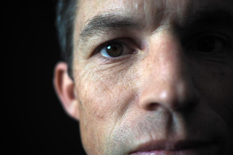 Man`s portrait with dramatic light, black background. Man`s portrait with dramatic light, with a black background royalty free stock photography