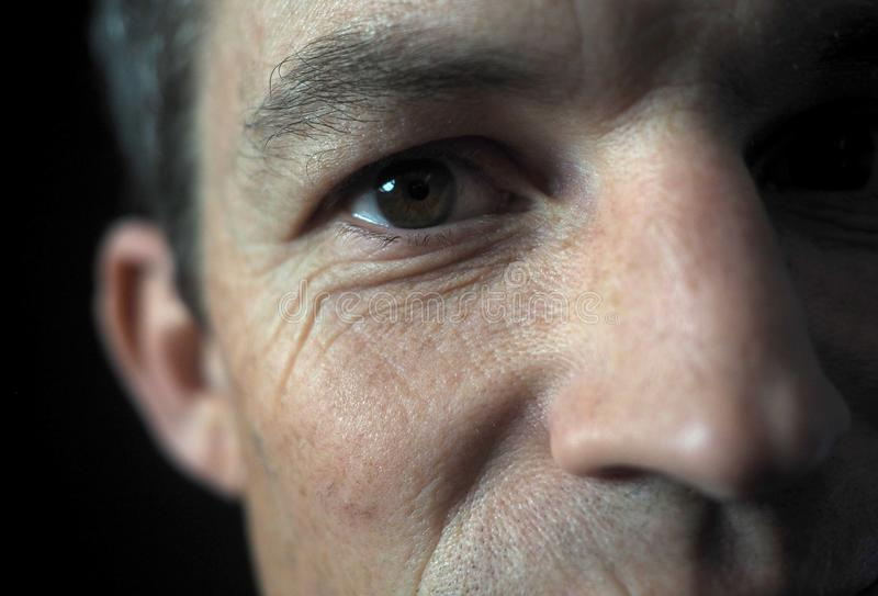 Man`s portrait with dramatic light, close up on eye royalty free stock image