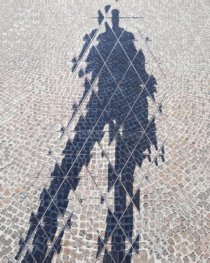 Man's shadow on the floor, urban street, digital illustration stock image