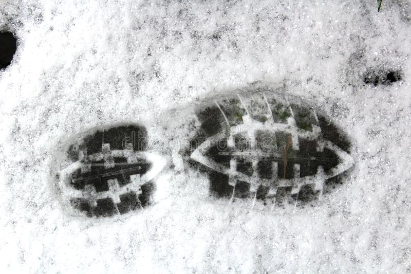 Man Shoe Print in the Snow royalty free stock images