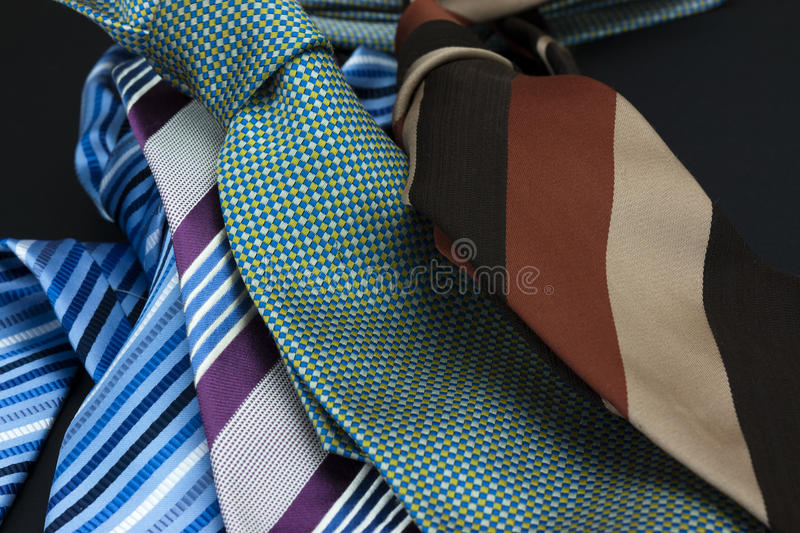 Man's tie on a black background stock image