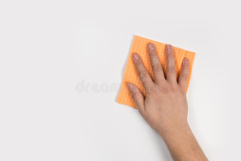 Man`s hand cleaning on a white background stock photo