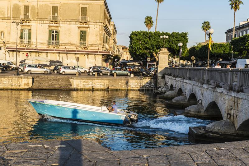 Man sailing in a boat next in Siracusa, Sicily, Italy royalty free stock photography