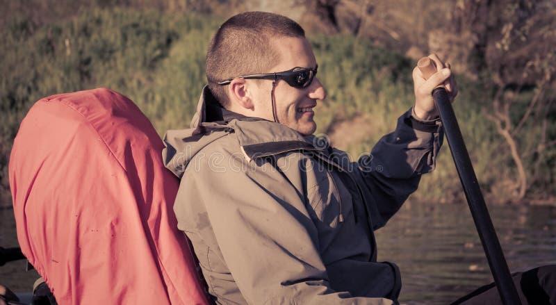 Man sailing on canoe stock photos