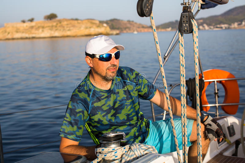 Man on the sailing yacht boat. Sport. royalty free stock photos