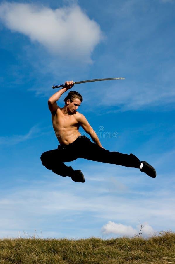 Man samurai sword sky royalty free stock image