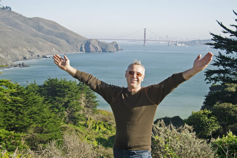 A man in San Francisco, Golden Gate Bridge royalty free stock images