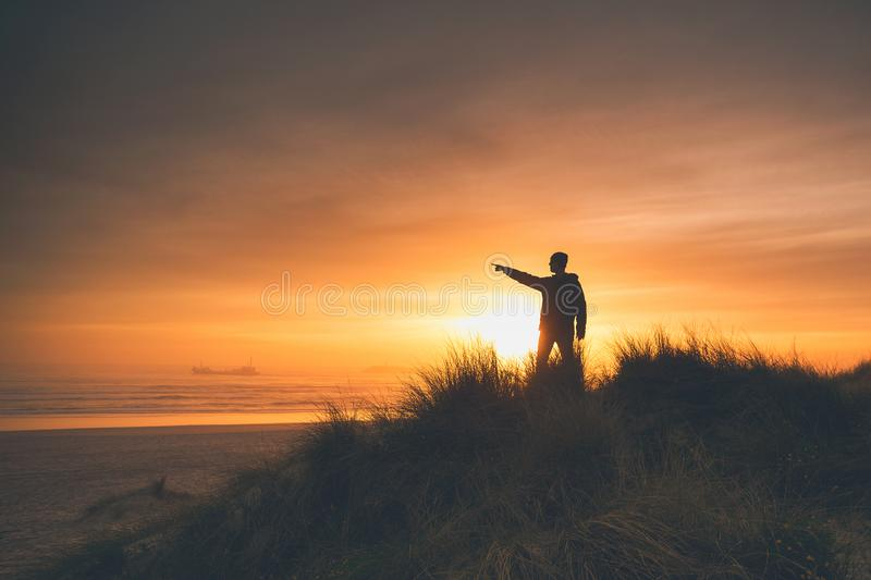 Freedom and sunset stock photography