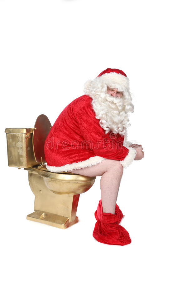 Man in Santa costume sitting on a golden toilet. Santa sitting on a golden toilet with his pants down royalty free stock photo