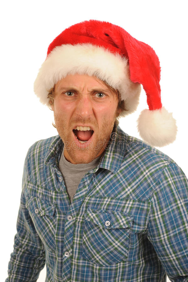 Man with santa hat. Man wearing a Santa Claus hat yelling stock photography