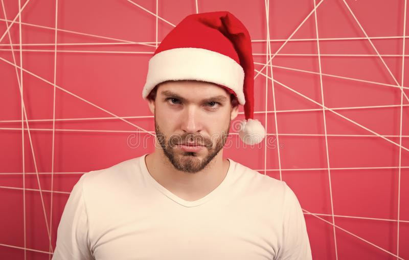 Man in santa hat hold christmas present. delivery christmas gift. online christmas shopping. Happy new year. The morning. Before Xmas. happy santa man royalty free stock photography