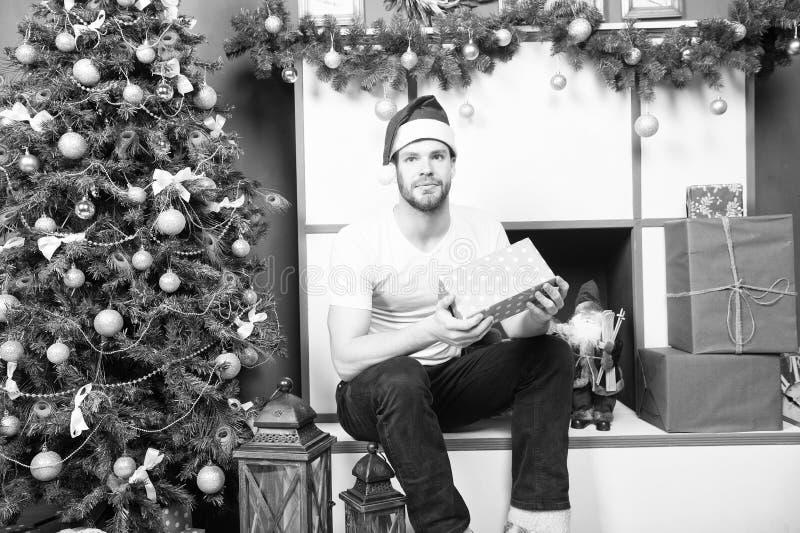 Man santa with presents at xmas tree stock photos