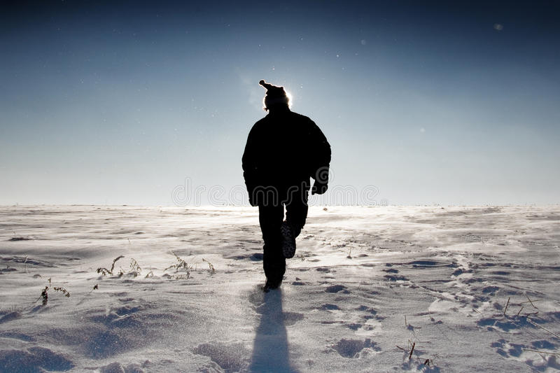 Man In Santa's Hat Walking On Snow Field royalty free stock photography