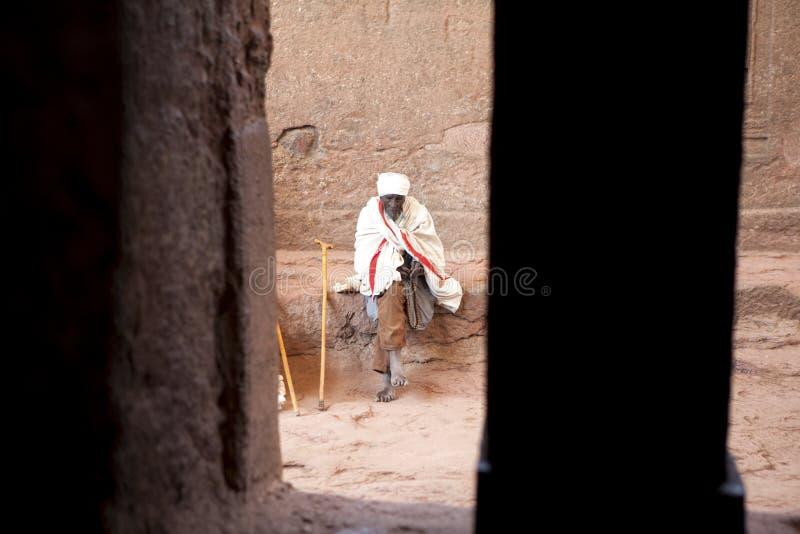 Man sat outside a church, Ethiopia royalty free stock photo