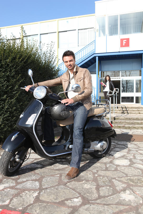 Download Man sat on scooter stock image. Image of guard, spoke - 23698035