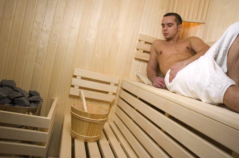 Man in sauna stock photo