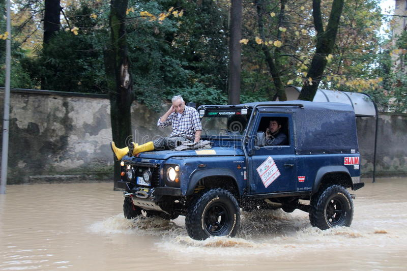 Man saved from the waters on the hood of a jeep In Marina di Carrara. Images taken during the flooding of the Carrione River, Marina di Carrara (Tuscany, Italy) royalty free stock photography