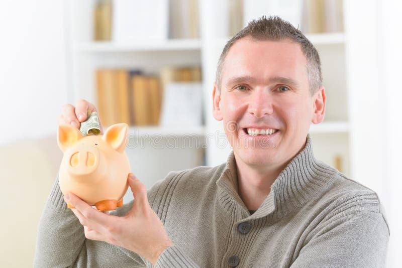 Man saving money royalty free stock photo