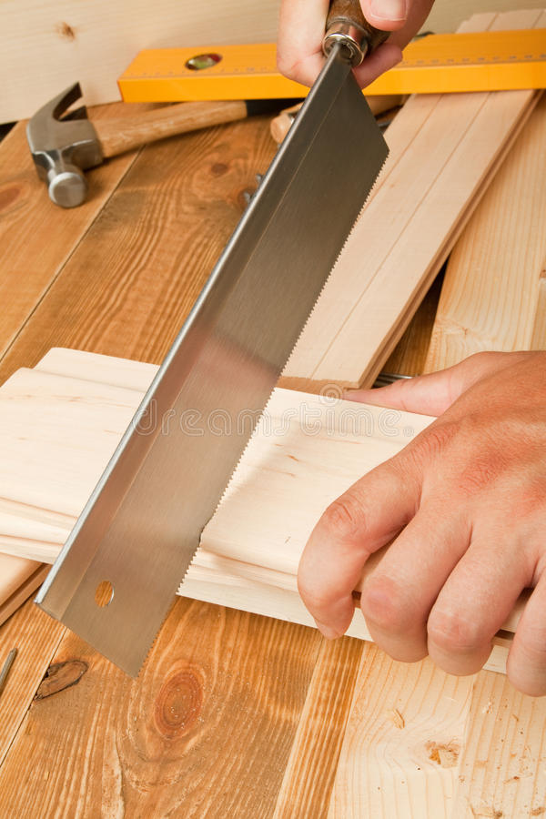Download Man sawing plank stock photo. Image of plank, level, auger - 22442058