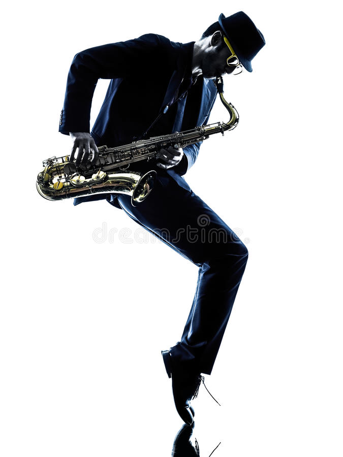 Man saxophonist playing saxophone player. One caucasian man saxophonist playing saxophone player in studio silhouette isolated on white background stock photo