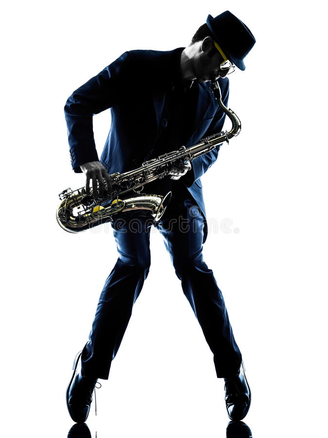 Man saxophonist playing saxophone player silhouette. One caucasian men saxophonist playing saxophone player in studio silhouette isolated on white background royalty free stock photo