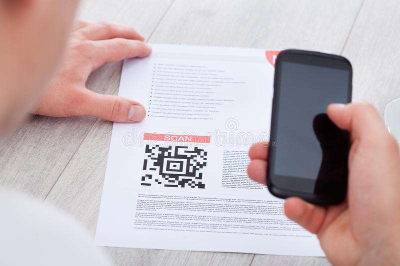 Man scanning barcode. Close-up Of Hand Holding Mobile Scanning Bar Code stock photos