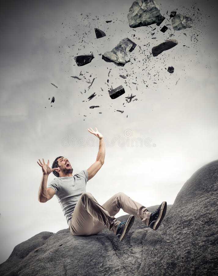 Man scared of some rocks royalty free stock photo
