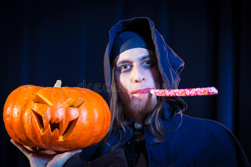 Man in scary Halloween costume with pumpkin royalty free stock photo